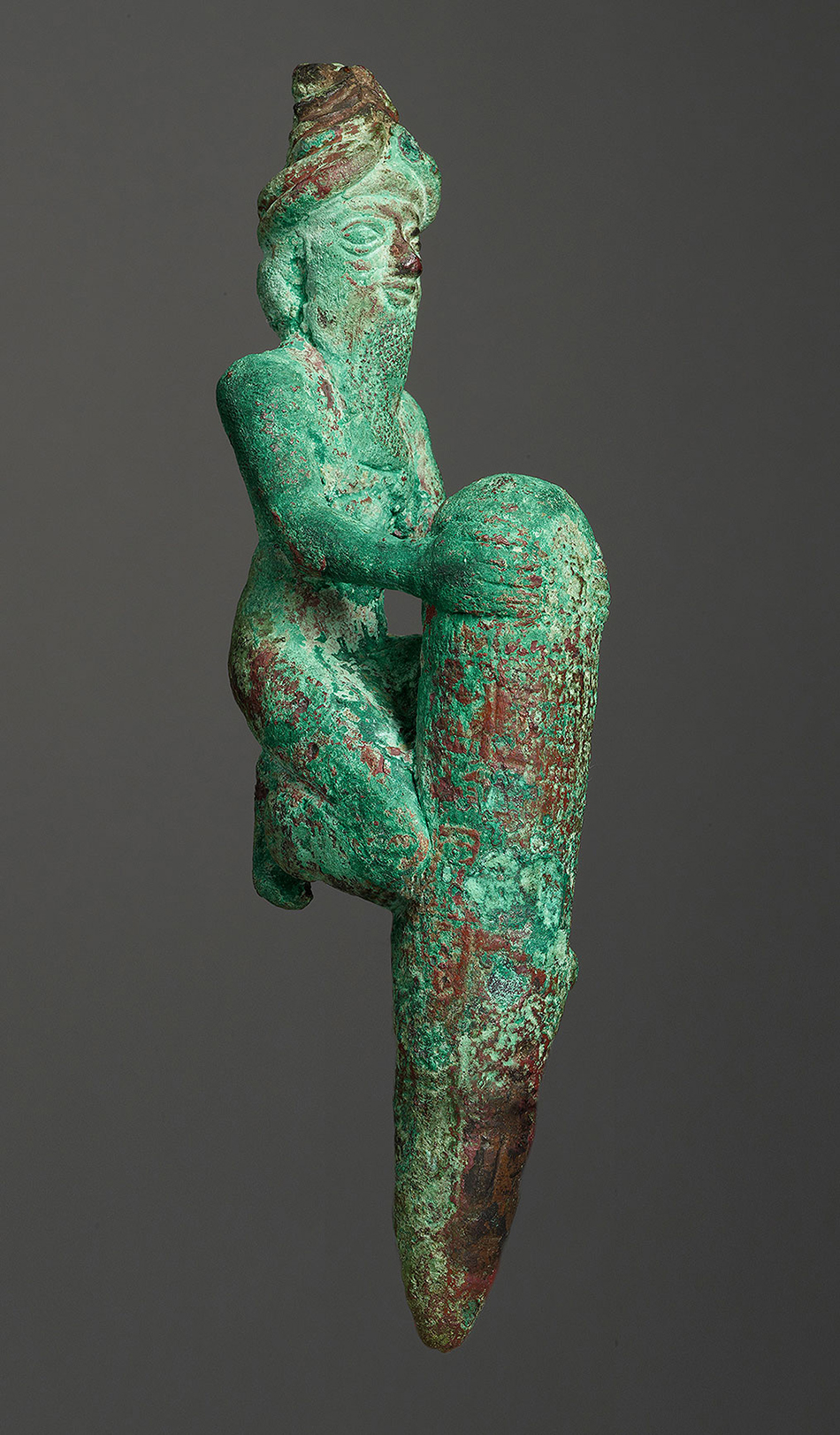 foundation-figure-of-a-kneeling-god-holding-a-peg