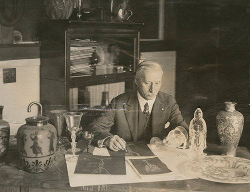 frederick-carder_portrait-at-desk_500w