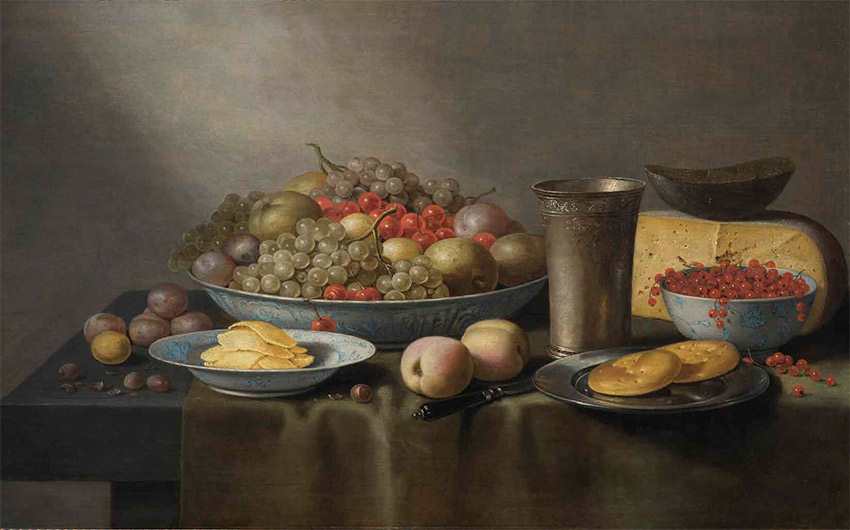 Floris Gerritsz. van Schooten_dutch_A Still Life of Fruit in Wanlikraak Porcelain Bowls, Cheese, a Silver Beaker, and Bread on a Pewter Plate on a Draped Table_850-W
