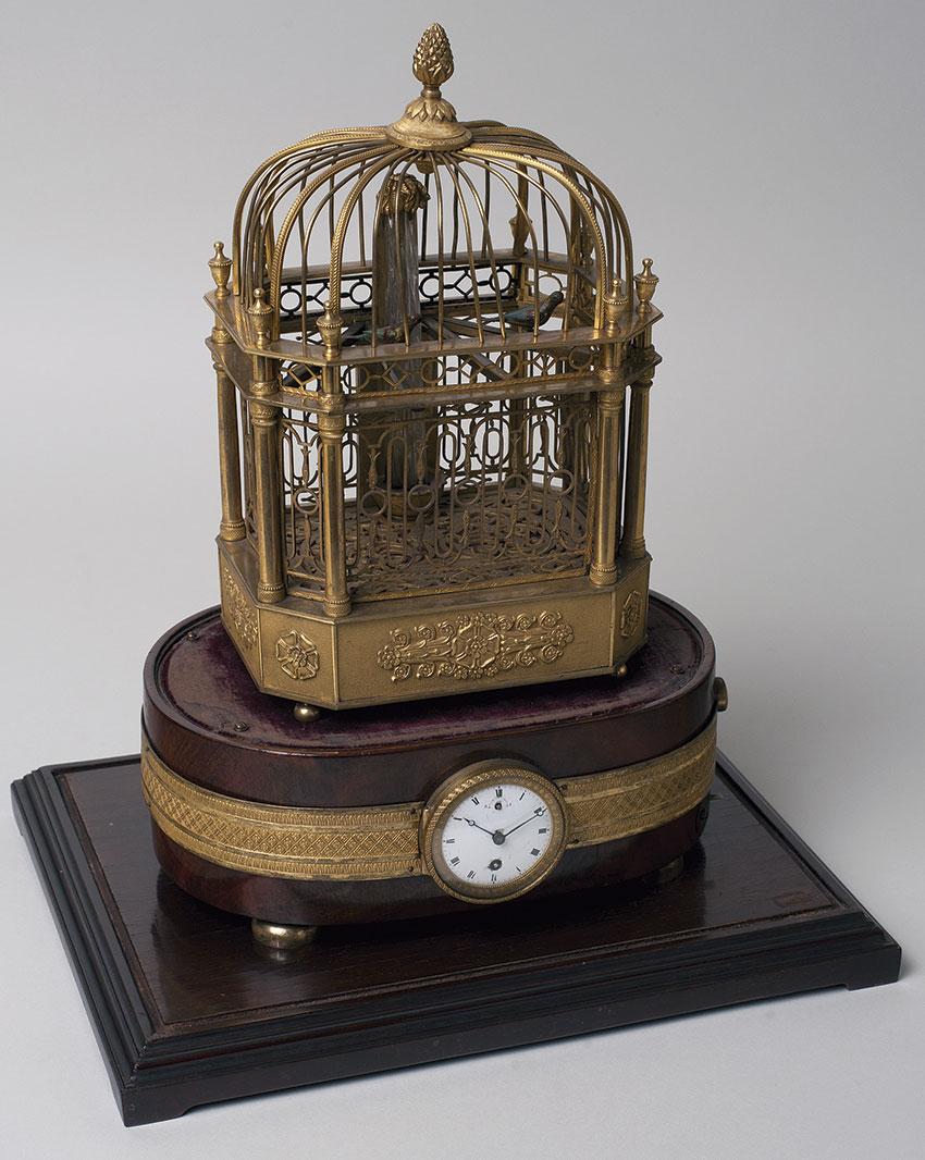 11 Reloj automata suizo. Jaula de pajaros por F. Nicole. Principios S. XIX. 37x34x15 cm. Nº Inv. P.O. 233