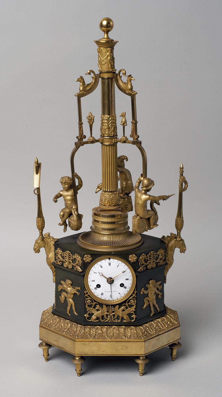 18_Carrusel. Reloj frances de sobremesa automata en bronce dorado por Vaillan. Circa 1805. 54,5 x 23,5 x 18 cm. Nº Inv. R.A. 643