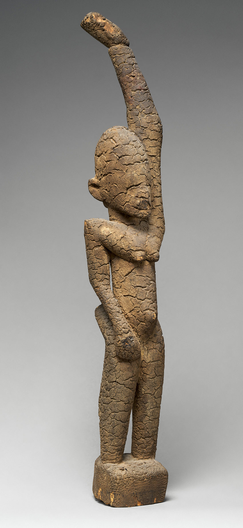 Female-Figure-with-Raised-Arm.-Mali-Ireli_-Tellem-civilization_15th–17th-century-Wood_African-Art.j